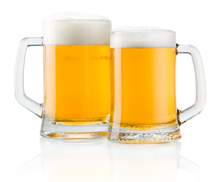 frothy: Two mug of fresh beer with cap of foam isolated on white background