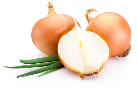Cut fresh bulbs of onion on a white background