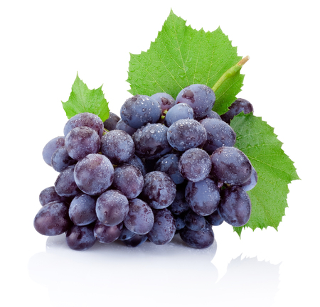 Fresh bunch of grapes with leaves isolated on a white background