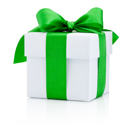 isolated on green: White gift box tied green ribbon Isolated on white background