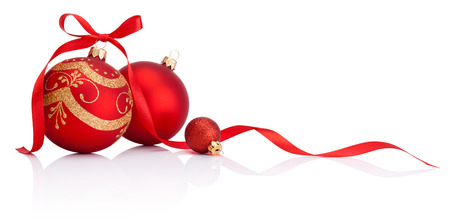 baubles: Red christmas decoration baubles with ribbon bow isolated on white background