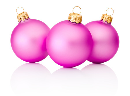 pink christmas: Three pink Christmas baubles Isolated on white background Stock Photo