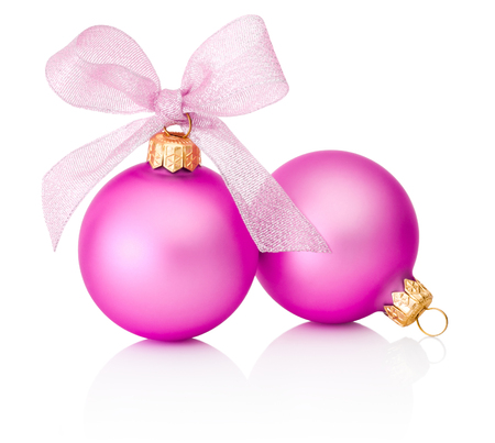pink christmas: Two pink Christmas baubles with ribbon bow Isolated on white background