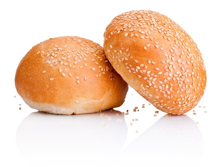 white sesame seeds: Two sandwich bun with sesame seeds isolated on white background