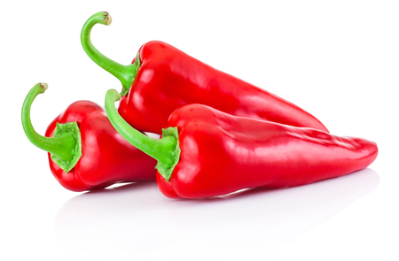 chilies: Two red hot peppers isolated on white background