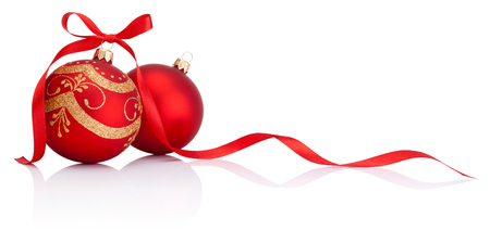 Red christmas decoration baubles with ribbon bow isolated on white background