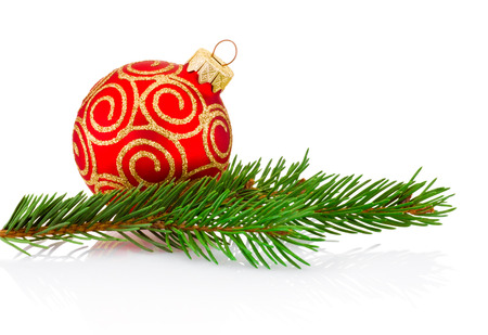 Christmas red decoration bauble and fir tree branch Isolated on white background