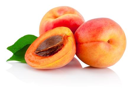 fresh leaf: Fresh cut apricot fruits with leaf isolated on white background Stock Photo