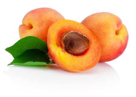 apricot kernels: Fresh cut apricot fruits with leaf isolated on white background Stock Photo