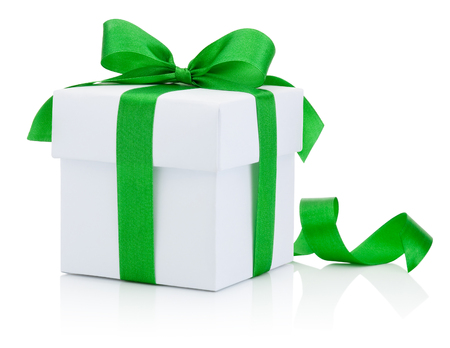 White gift box tied green ribbon bow Isolated on white background Banco de Imagens