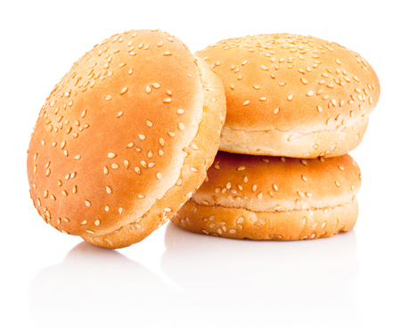 Three hamburger buns with sesame isolated on a white background