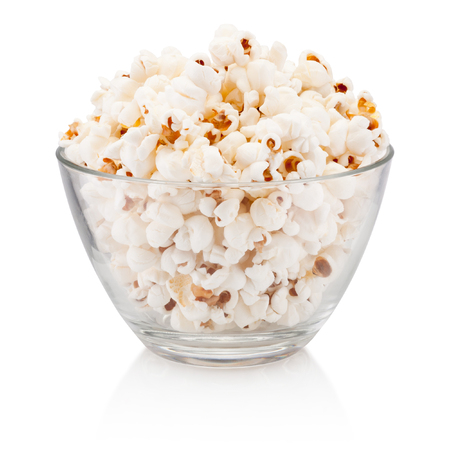 Popcorn in glass bowl isolated on a white background