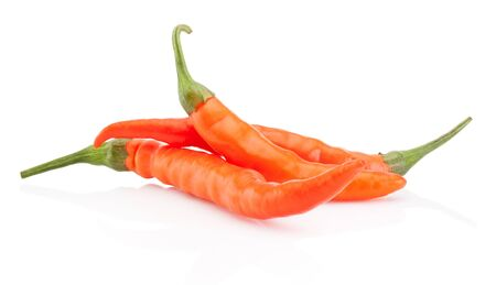 Three orange hot chili pepper isolated on a white background