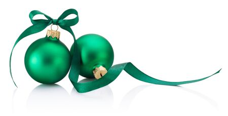 Two green Christmas baubles with ribbon bow isolated on a white background