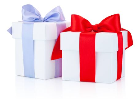 Two white gift boxes tied a red and blue ribbon bow Isolated on white background Stockfoto