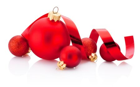 Christmas red baubles and curling paper Isolated on a white background Stockfoto