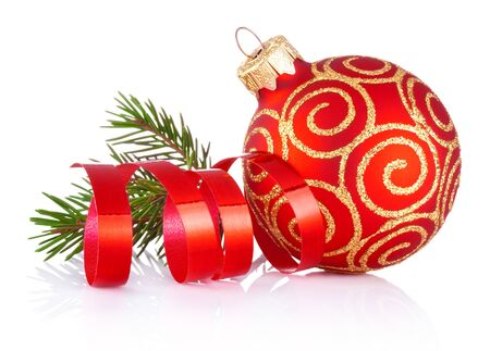 Christmas red decoration bauble, curling paper and fir tree branch Isolated on a white background