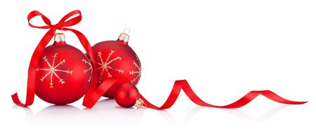 Red Christmas decoration baubles with ribbon bow isolated on white background Stock Photo