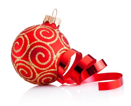 Christmas red decoration bauble and curling paper Isolated on a white background