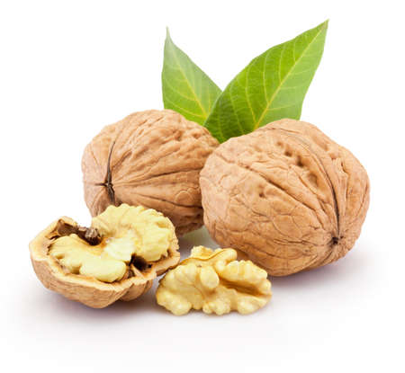 Walnuts with leaves isolated on a white background