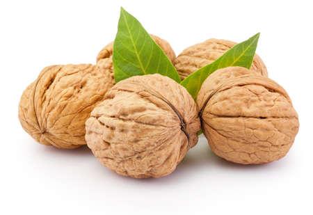 Whole walnut with leafs isolated on a white background Standard-Bild