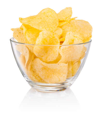Potato chips in glass bowl isolated on a white background