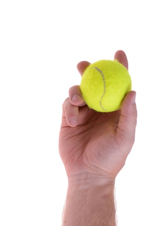 tennis ball: hand holding tennis ball ready to serve