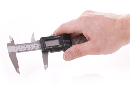 Hand holding vernier for measurment on white background photo