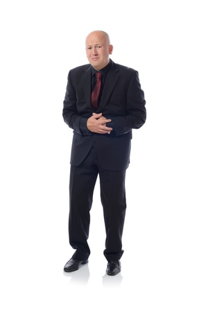 Businessman holding his stomach in pain or indigestion Stock Photo - 16305121