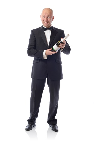 Middle aged Man in Tuxedo Holding a Champagne Bottle over a white background  photo