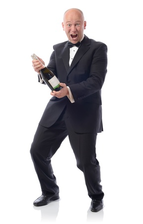 Man in tuxedo with a bottle of champagne winning photo