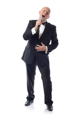 Man in a tuxedo singing isolated on white  photo