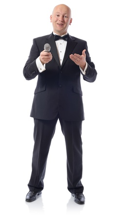 Man in a tuxedo offering microphone isolated on white  photo