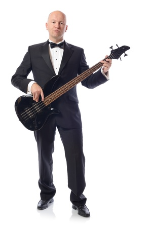 Man in a tuxedo playing bass guitar isolated on white