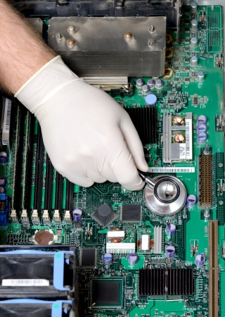 Silver stethoscope lying down on an server motherboard photo