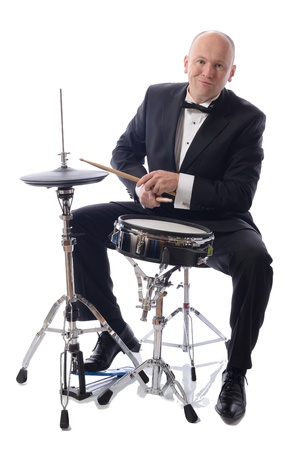 man in tuxedo playing drums isolated on white Stock Photo