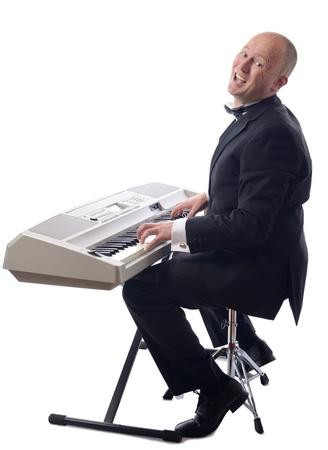 man in tuxedo playing keyboard