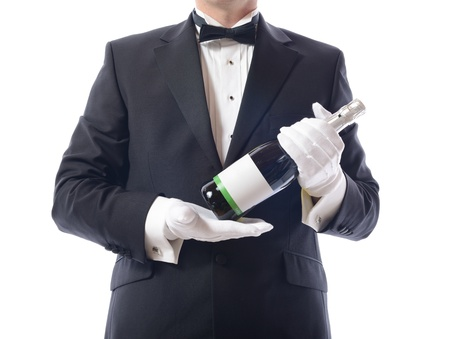 Man in tuxedo with a bottle of champagne photo