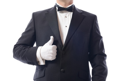 man in tuxedo giving the thumbs up isolated on white
