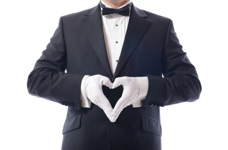 express feelings: man in tuxedo with hamds in heart shaped pose