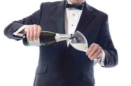 Man in Tuxedo Pouring Champagne isolated over white  photo