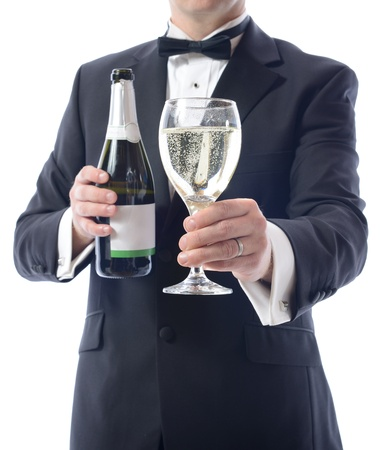 Man in tuxedo with a bottle of champagne and glass of wine photo