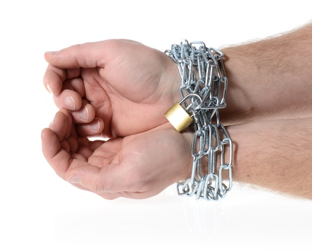 hands ties in chains with a lock Stock Photo - 16385351