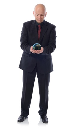 man in a suit holding the planet earth isolated on white background photo