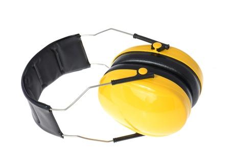 elementos de protección personal: Amarillo de trabajo auriculares protectores, se encuentra aislado en blanco Foto de archivo