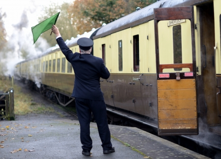 train guard signaling for train to depart Stock Photo