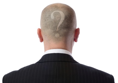 asking: Rear view of bald man with a question mark shaved into hair wearing suit over white background