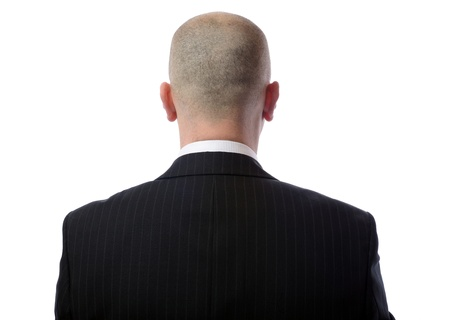 head shot: Rear view of bald man wearing suit over white background