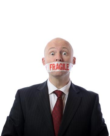 shut: man with fragile tape over mouth concept of diplomacy or censorship isolated on white Stock Photo