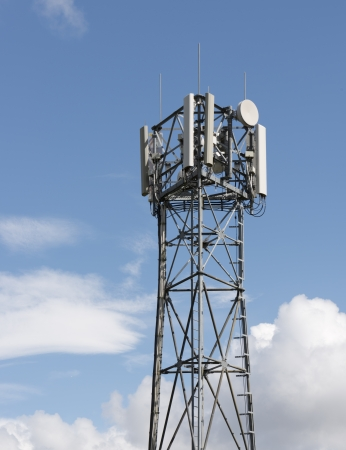 communications wireless tower with telephone dish photo